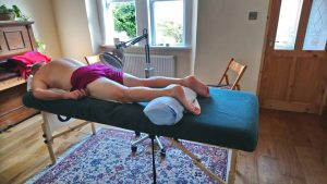 Muscular injury treatment being carried out at my Corsham Shiatsu and Acupuncture Clinic:- The patient is being treated with Acupuncture together with an infa-red heat lamp, which helps speed up the healing process