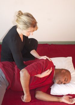 Picture of Sarah treating a patient with Shiatsu